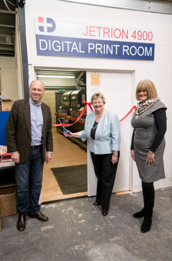 PID Labelling Systems' John Mayers with South Derbyshire MP Heather Wheeler and Melbourne Parish Council Chair Wendy Earp at the ribbon cutting ceremony for the company's new EFI Jetrion digital label production line.