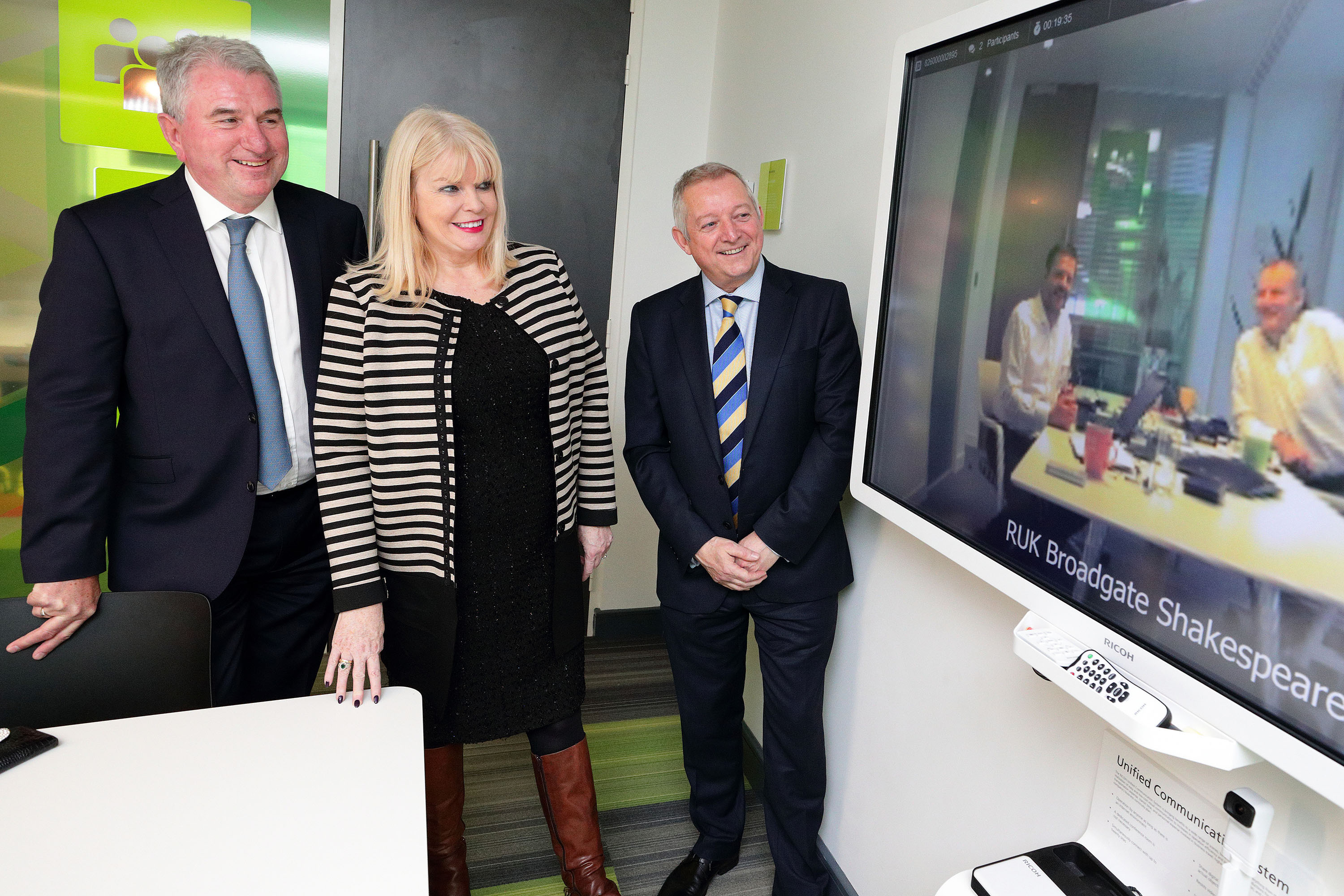 (2)	Pictured talking via videoconference to Ricoh colleagues at the opening of Ricoh's new Irish headquarters in Airside Business Park, Swords, Co. Dublin are (L to R) Phil Keoghan, CEO, Ricoh UK and Ireland; Minister for Jobs, Enterprise & Innovation, Mary Mitchell O'Connor TD; and Gary Hopwood, General Manager, Ricoh Ireland