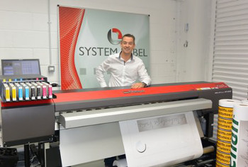 Alan Beirne stands proudly behind his SOLJET PRO4 XF-640 printer